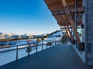 Modern Colorado mountain home with view of snowy mountains