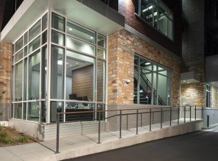 Cable railing system for bank entrance ramp.