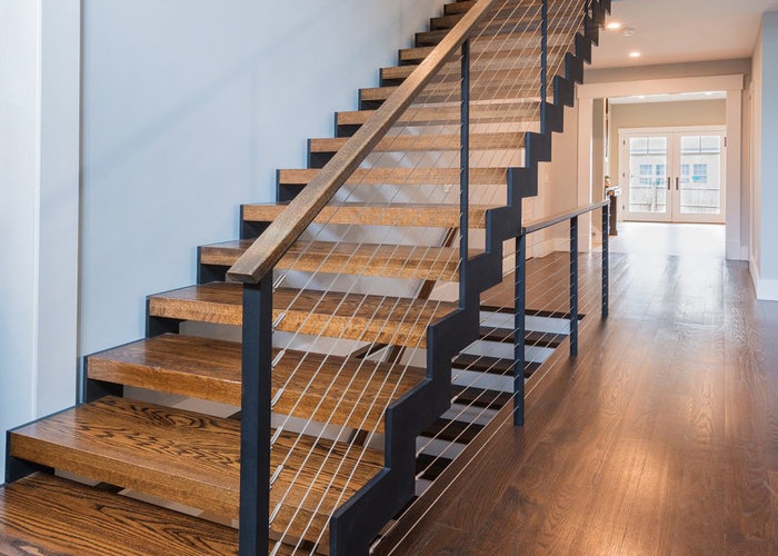 Zigzag stairs with American red oak treads and top rail.
