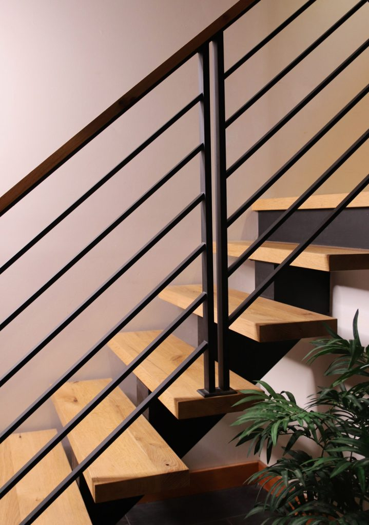 Floating stairs with custom flat bar railing posts