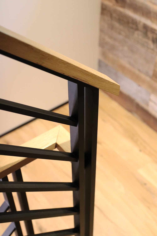 Bar railing with reclaimed white oak top rail.