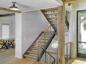 U shaped enclosed double stringer staircase by Keuka Studios