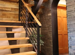 U-shaped floating staircase with white oak treads.