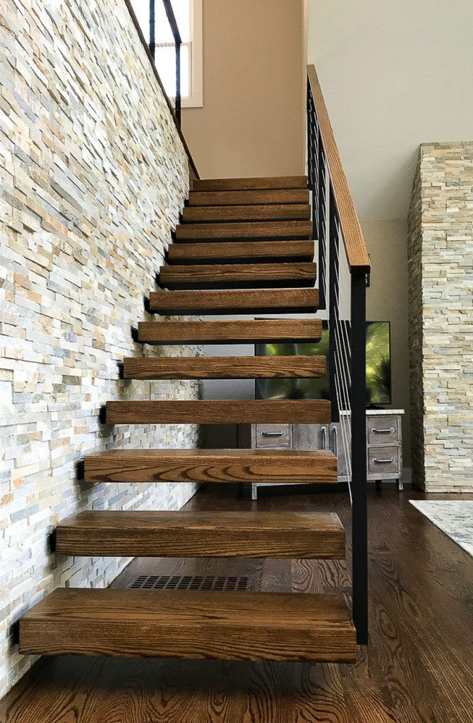 Floating stair treads against stone wall. Treads are Red Oak with Steel stringer structure.