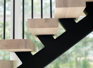 Floating stair and white oak treads with pencil rail