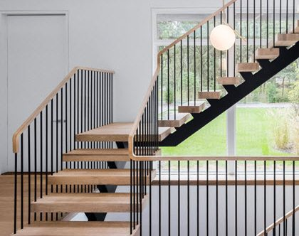 modern floating staircase with spindles
