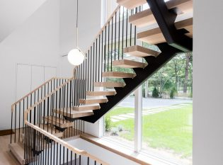 Mono-stringer stairs with white oak treads and top rail