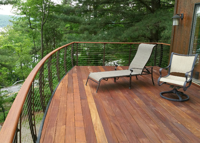 curved raised deck in the forest with IPE decking.