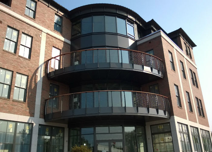 multi-lvedl condominium curved decks with the curved Keuka style railings.