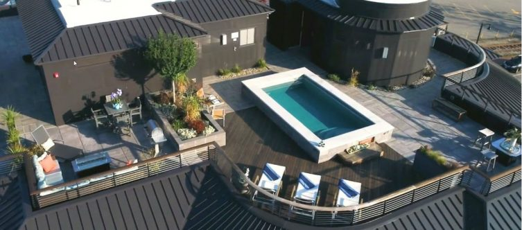 rooftop pool deck with curved cable railing