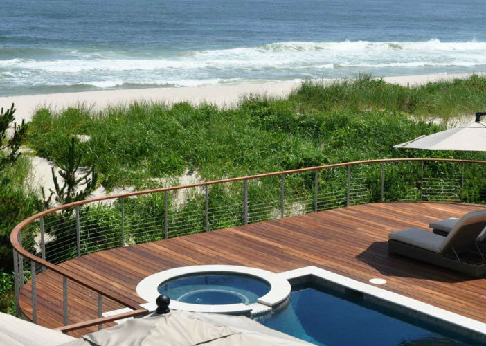 Curved pool deck railing oceanside