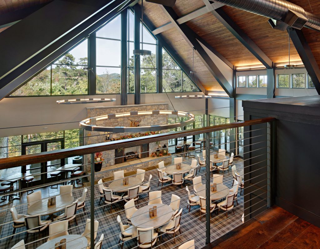 Overlooking corporate retreat dining atrium through cable railings