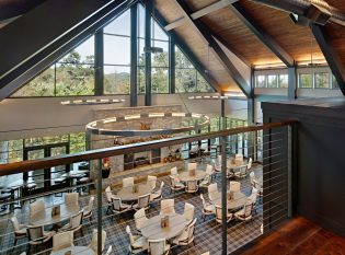 Cable railings on loft overlooking corporate dining area