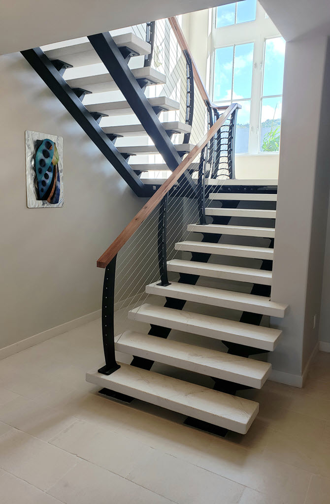 Limestone treads on a steel stair with keuka curved cable railing system