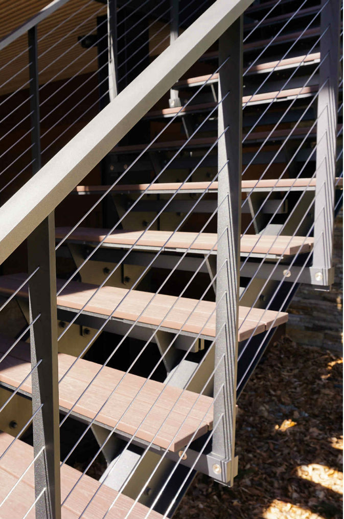 Composite treads on floating cable railing staircase.