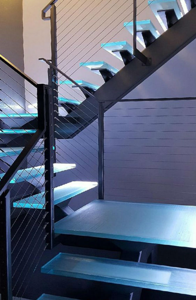 Glass Stair Treads on floating steel stringer stairs with led lighting.