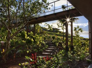 Lush Garden Walkway with Raised Bridge to Main Entry and cable Railings