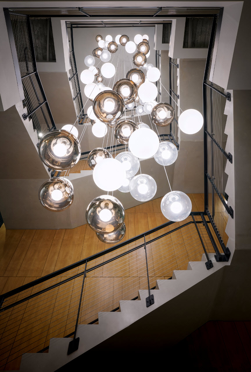 Looking up at beautiful lighting and lobby staircase