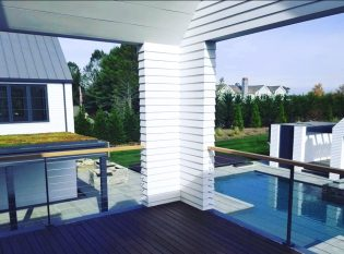 Cable railing system on master bedroom deck overlooking pool area