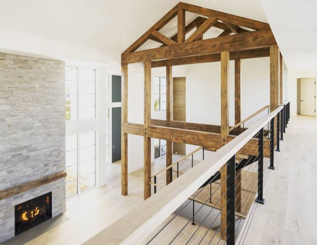 Modern farm house with black cable railing system on floating stairs and balcony.