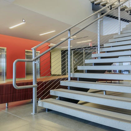 Industrial stairs with large extended handrail