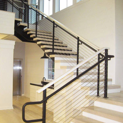 Refined looking railing with black extended railing and maple top rail
