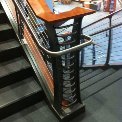 Round handrail seamlessly transitions between levels to meet ADA requirements