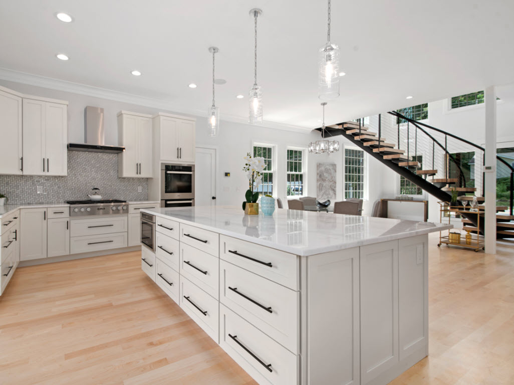 Expansive kitchen open to the living space with center entrance floating stairs.