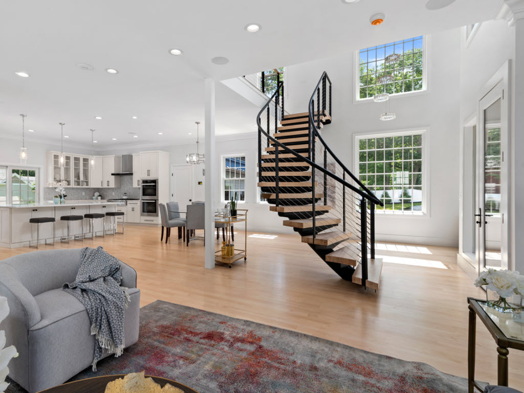 Open living space room with curved stairs
