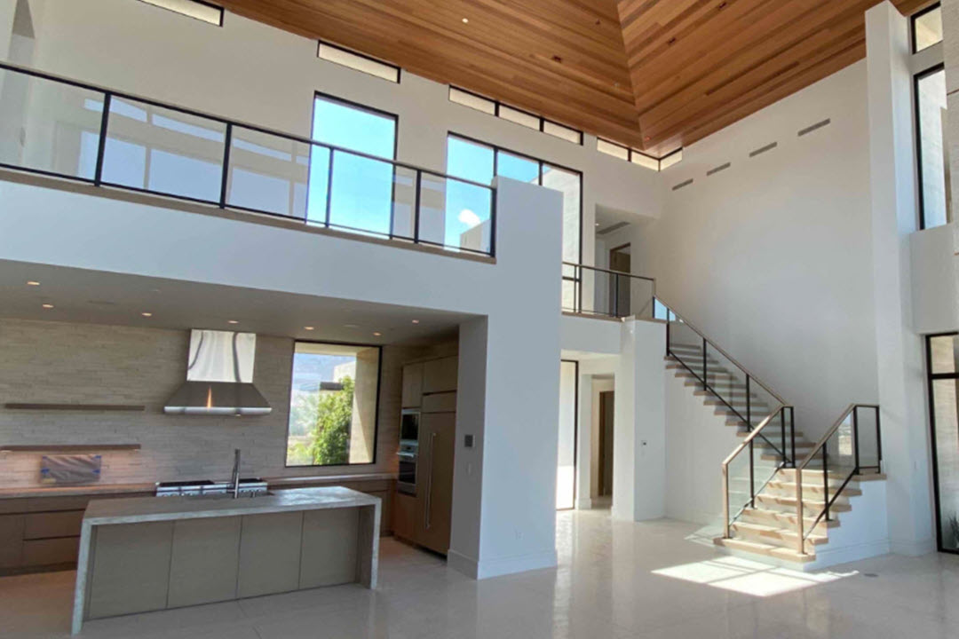 Glass balcony and modern glass stair railing in open concept home