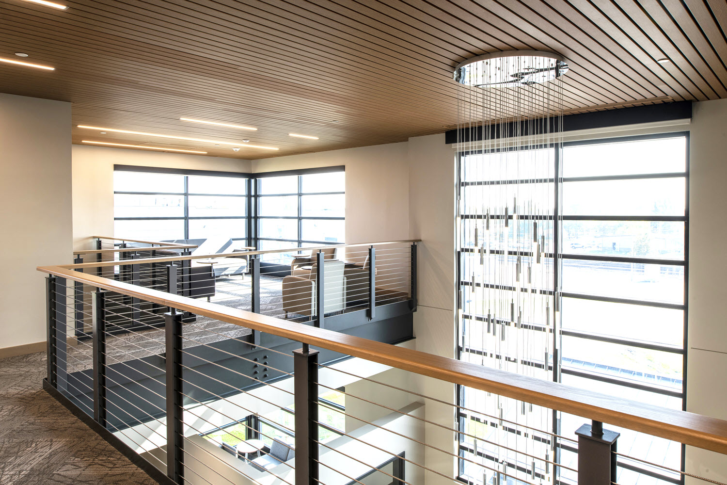 Office Atrium with industrial style cable railing system.