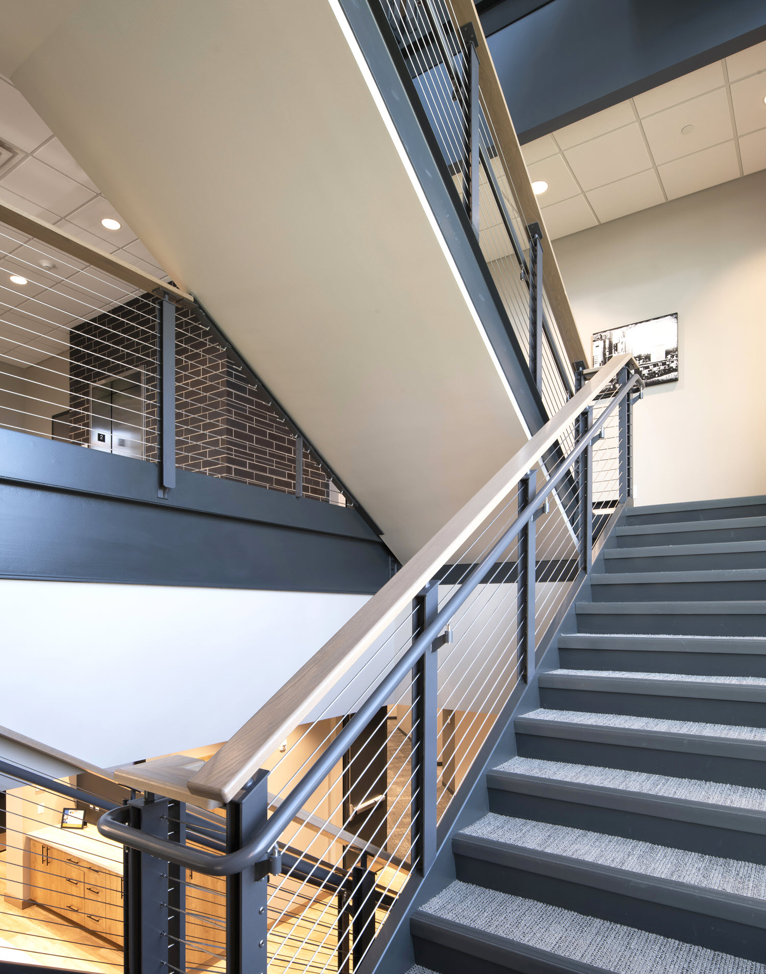 Interior office staircase with ADA handrails