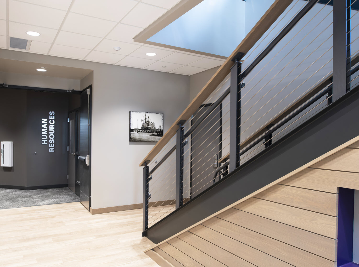 Main lobby entrance staircase with industrial style cable railing system