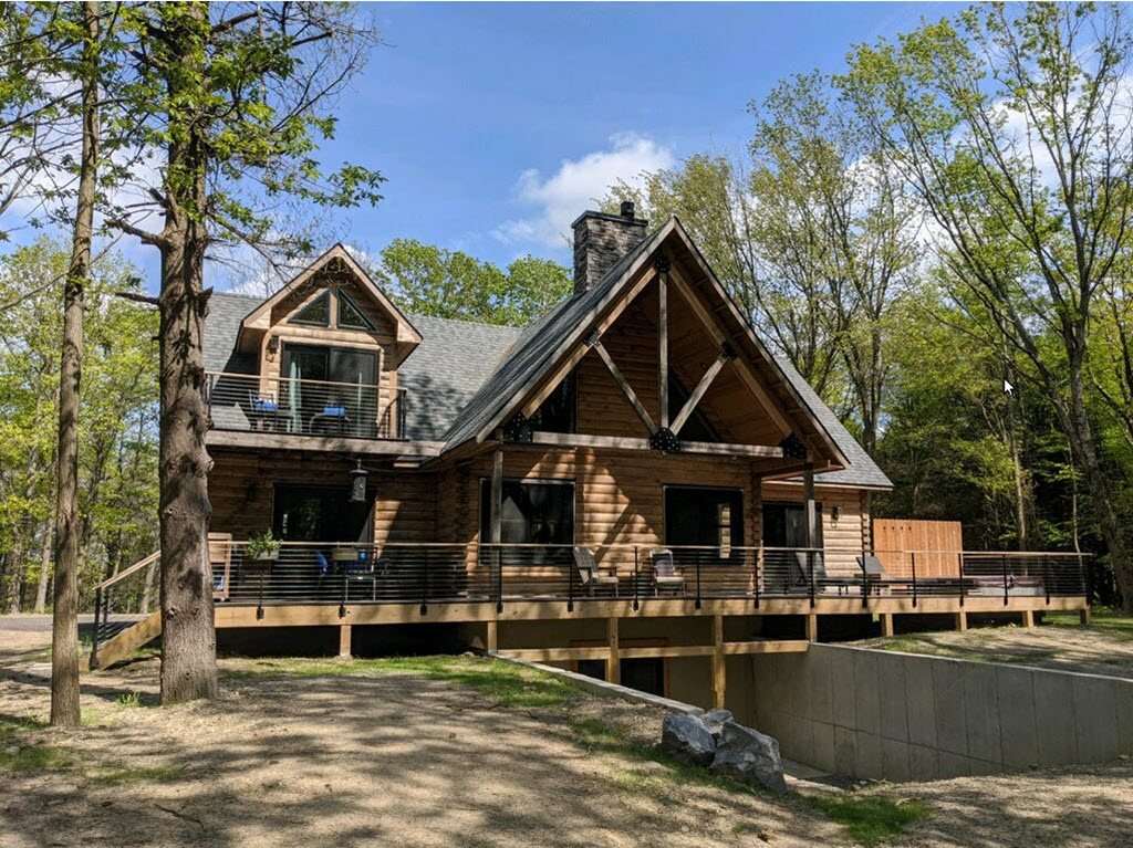 Log Cabin with expansive deck and cable railing system