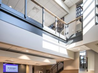 Modern Industrial style cable railing system on office balcony