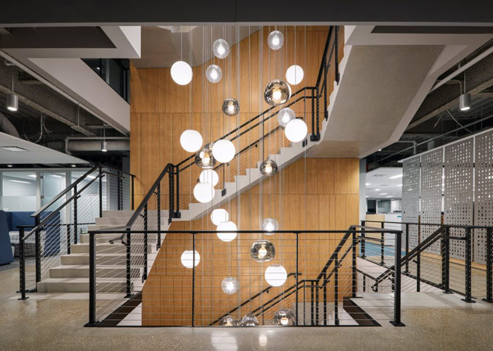 Cable railing on multi story staircase with ADA handrail and bubble lighting