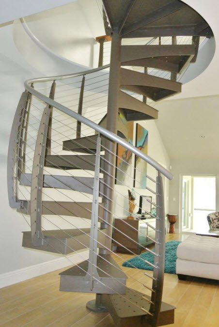 Spiral stairs with curved cable railing in condo