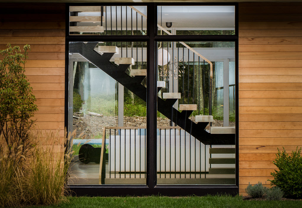 Floating stairs with pencil railings.