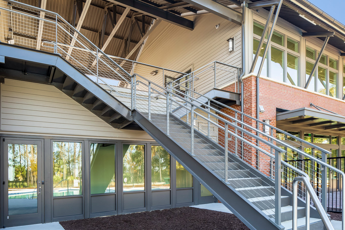 Split Exterior Staircase with Commercial Cable Railings and ADA handrails.