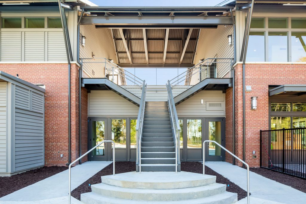 Grand commercial split staircase (bifurcated) entry with cable railing system