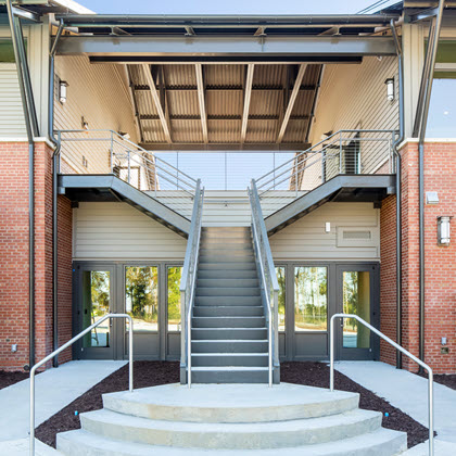 Split Staircase with cable railing system on modern waterfront facility