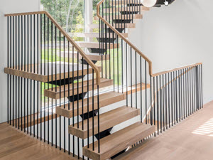 Floating stairs with spindle Railings and white oak treds