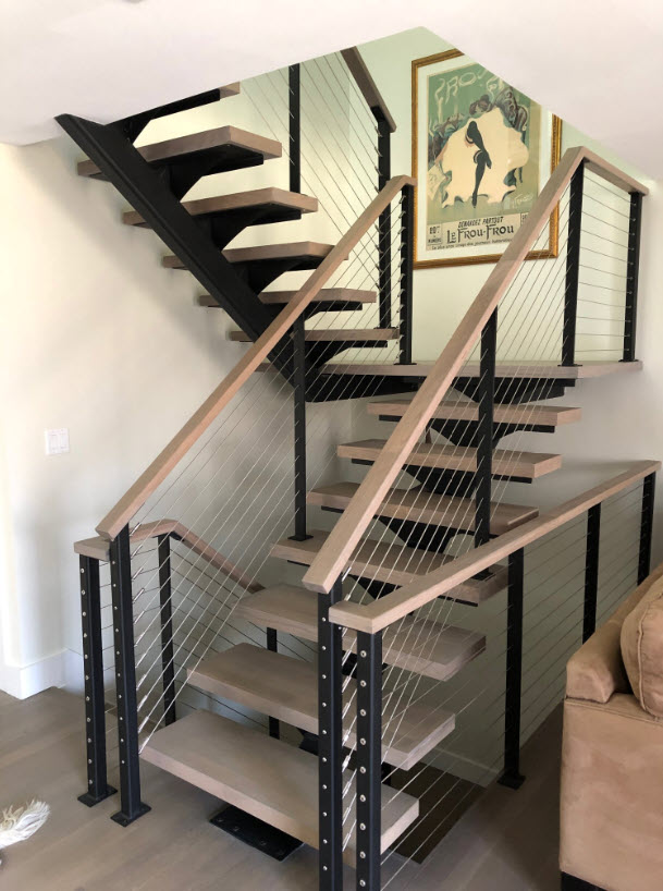 After Open floating stairs with cable railing system