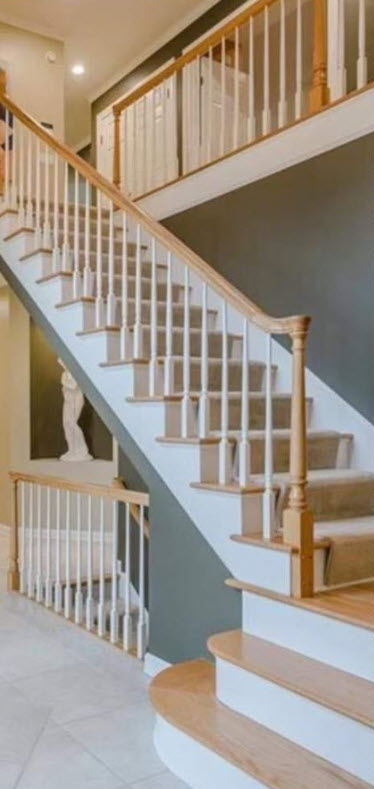 Before makeover traditional white spindle stair railinging