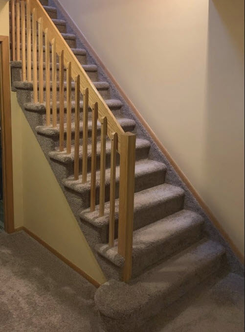 Before wood contemporary railing with carpet on stairs