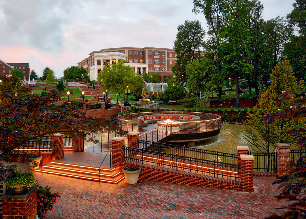 Fire pit over a waterfall surrounded by cable railing at High Point University