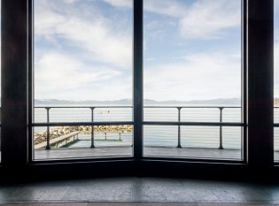 Views of Lake Tahoe through expansive window and deck wire rope railings