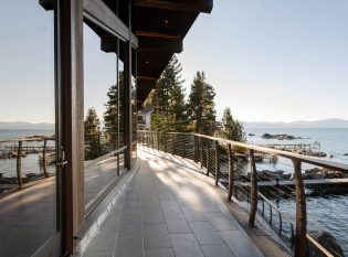 Expansive deck on Lake Tahoe with curved cable railing system