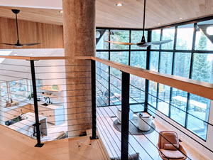 Great Room with upper level balcony and black cable railing system