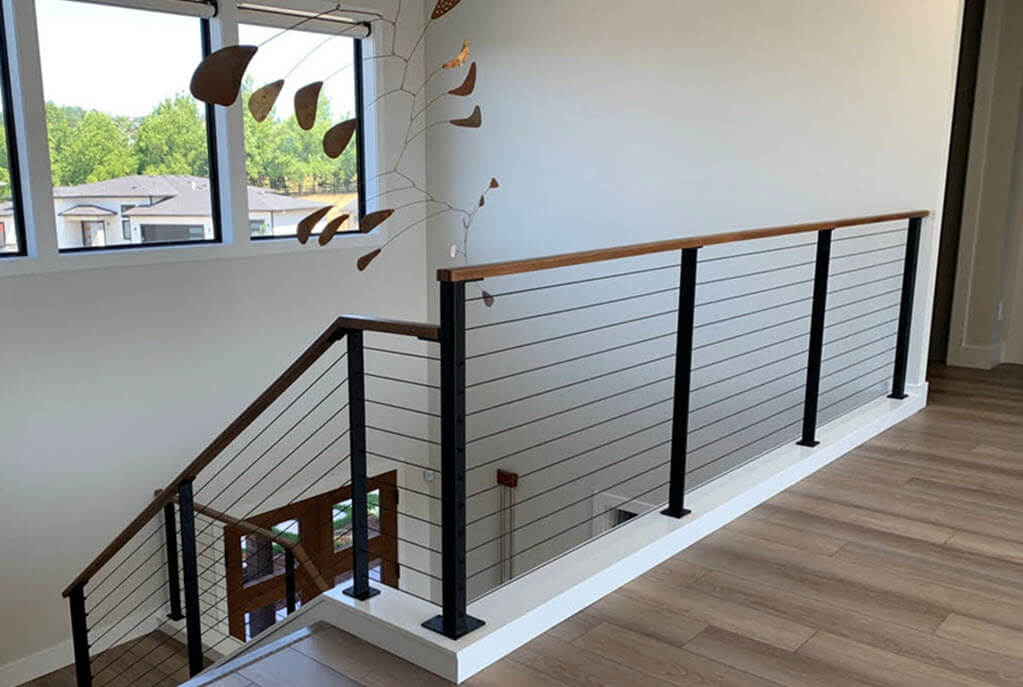 Minimalist home with black railings on the landing and stairs.